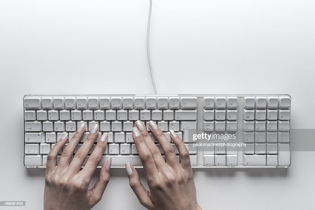 Beautiful girl hands typing on computer keyboard : Stock Photo