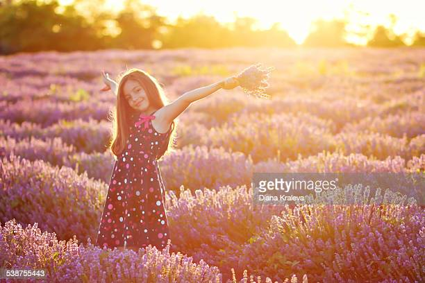 Beautiful girl in a field of lavender