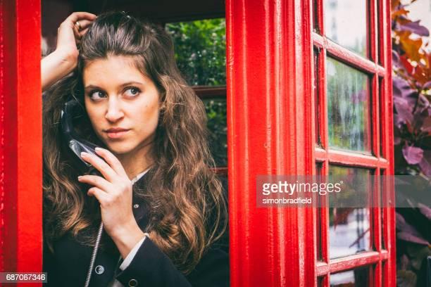 Beautiful Girl In A London Phone Box