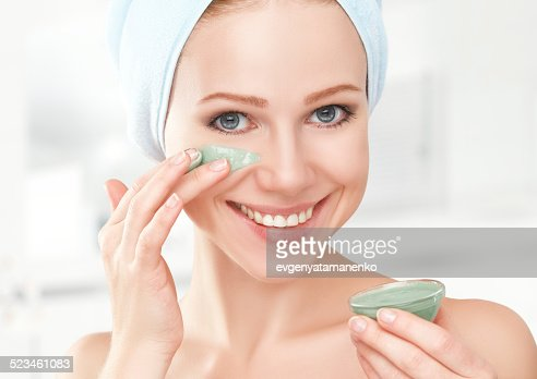 beautiful girl in bathroom and mask for facial skin care : Stock Photo