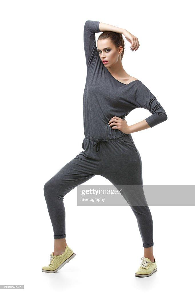 Beautiful girl in grey overalls : Stock Photo
