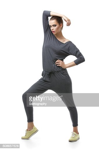 Beautiful girl in grey overalls : Stock Photo