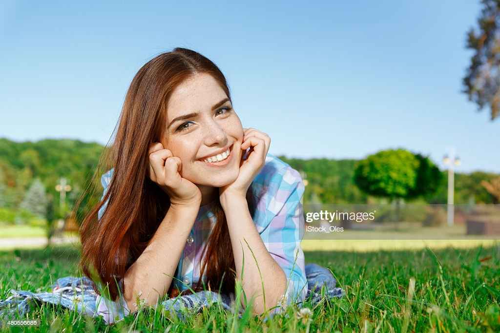 Beautiful girl in park smiling : Stock Photo