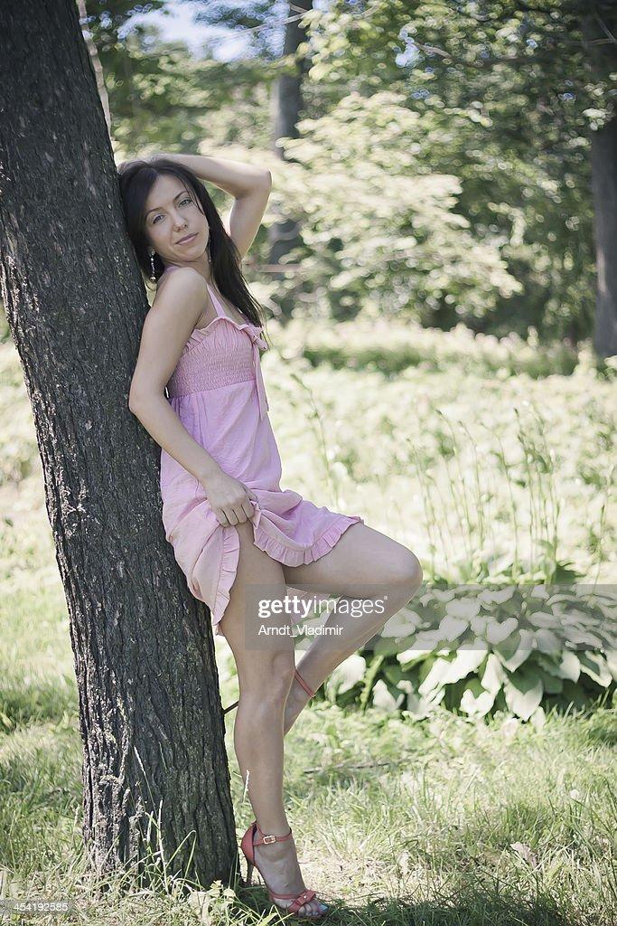 Beautiful girl in short pink dress. : Stock Photo