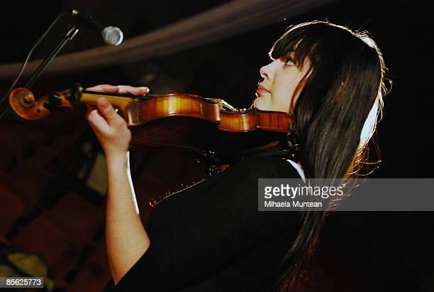 Beautiful girl is playing violin