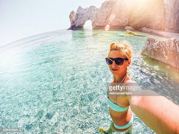Beautiful girl making selfie at the seashore