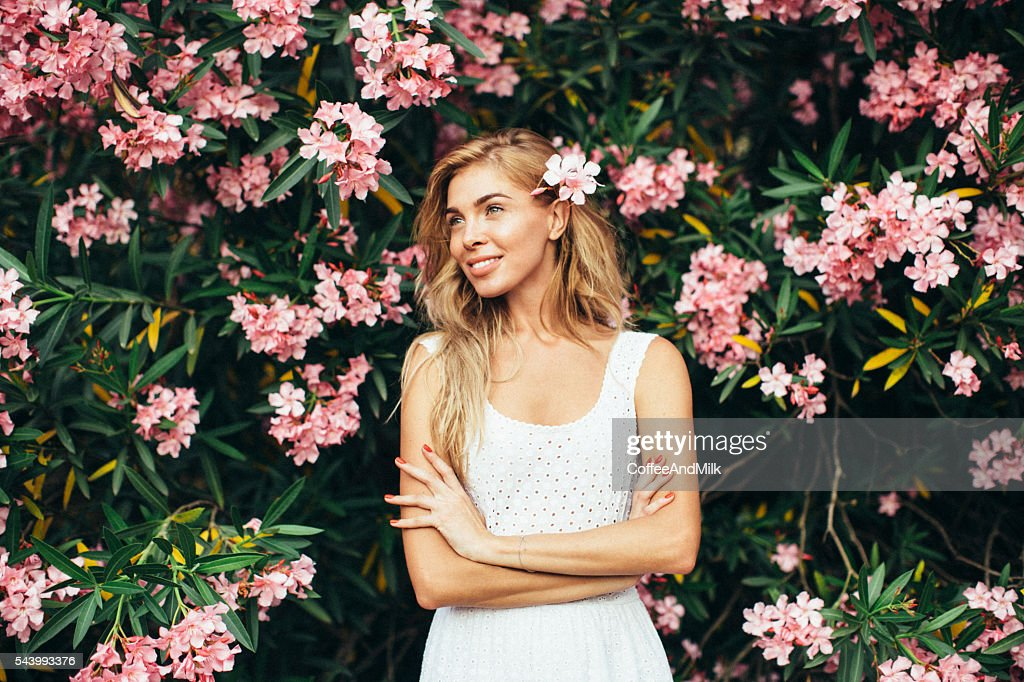 Beautiful girl on the background of spring bush : Stock Photo
