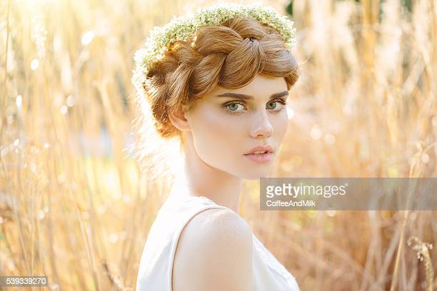 Beautiful girl on the background of spring field