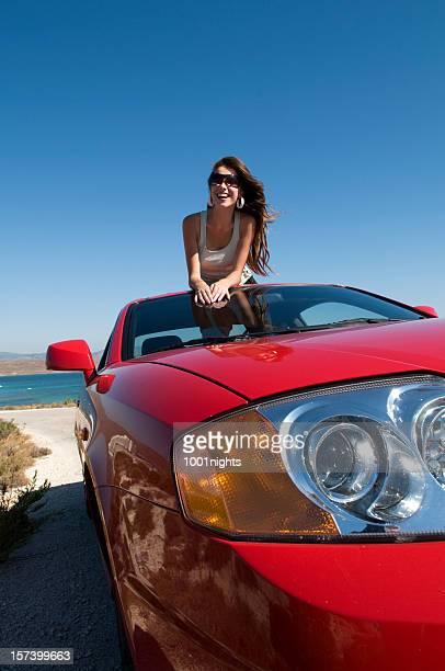 beautiful girl on the car
