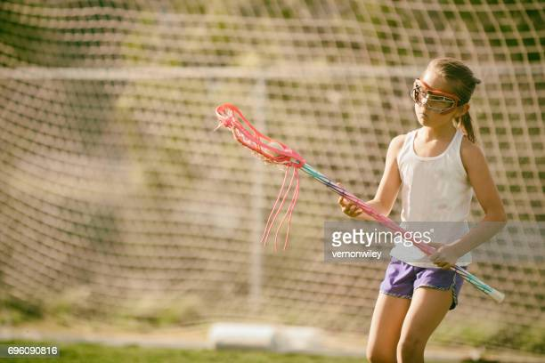 Beautiful girl playing lacrosse