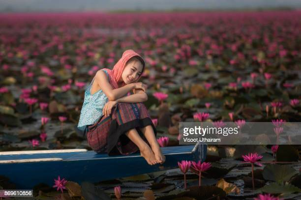 Beautiful girl sitting in boat.