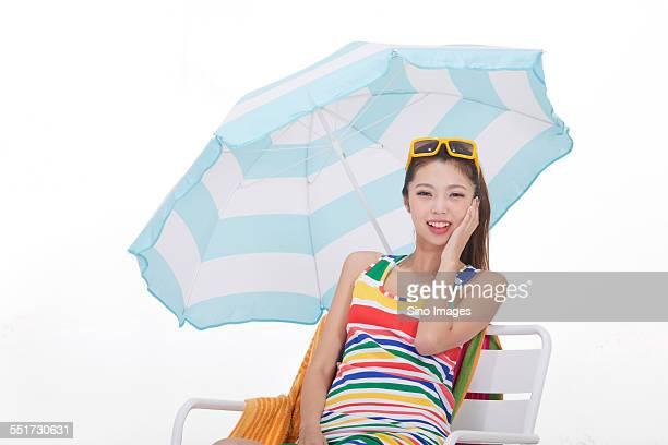 Beautiful Girl Sitting on a Beach Chair