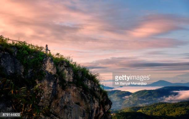 Beautiful Girl Standing On Mountain