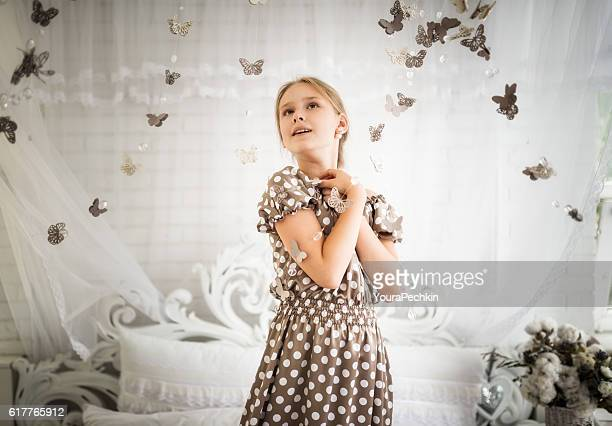Beautiful girl surrounds many butterfly