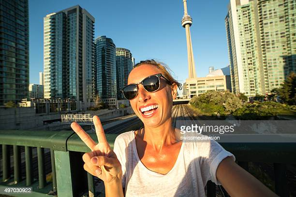 Beautiful girl taking selfie in Toronto-CN tower