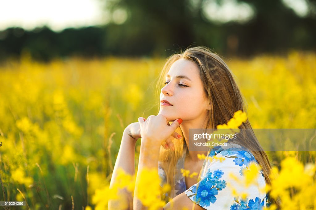Beautiful girl the flowers field flowers field sunse Healthy Lifestyle : Stock Photo