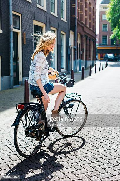 Beautiful girl with a bicycle.