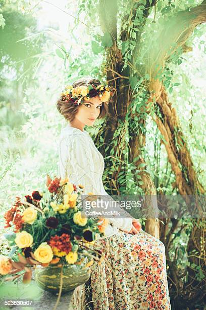 Beautiful girl with a wreath on her head