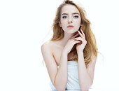 Beautiful girl with beautiful makeup, youth and skin care concept / photo of attractive blonde girl on white background