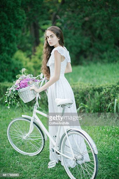 Beautiful girl with bicycle