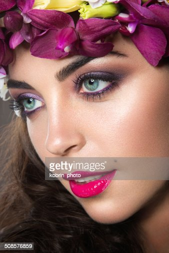 Beautiful girl with bright floral wreath on her head : Stock Photo