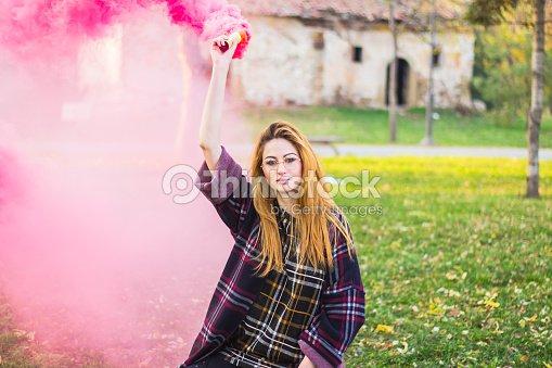 Beautiful Girl With Colored Smoke Bomb Stock Photo - Thinkstock