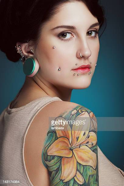 Beautiful girl with face piercing and tattoo