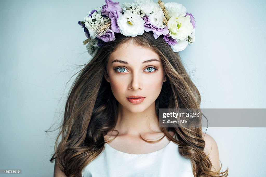 Beautiful girl with flower wreath : Stock Photo