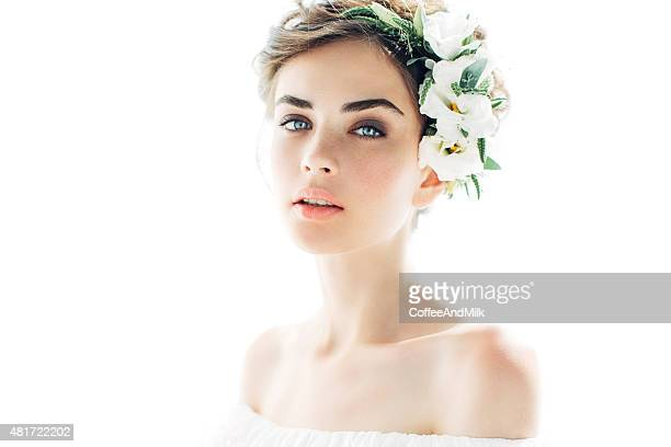 Beautiful girl with flower wreath