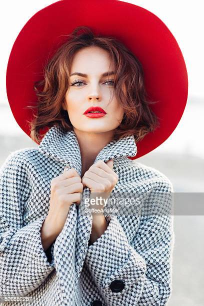 Beautiful girl with make-up and red hat