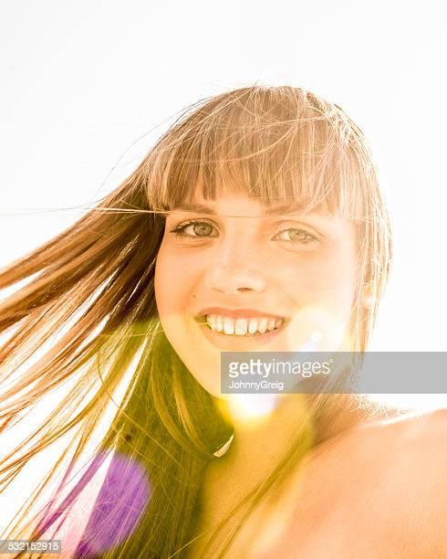 Beautiful girl with sun flare