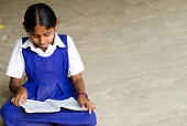 beautiful girl writing in a village school
