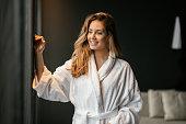 Beautiful glamorous woman in bathrobe enjoying wellness weekend