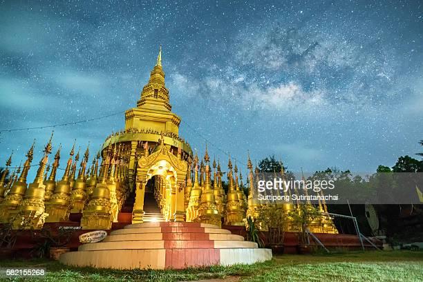 Beautiful golden pagoda of Pa sawangboon temple with milky way and star at night scene. Beautiful temple and Golden pagoda in Saraburi province , near bangkok , Thailand