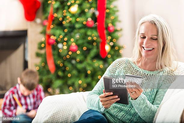 Beautiful grandmother smiles while making online purchase