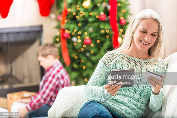 Beautiful grandmother uses tablet while shopping online