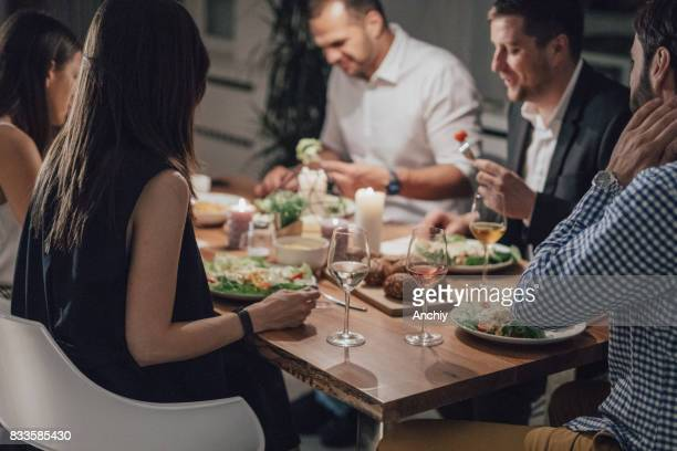Beautiful group of friends eating dinner together.
