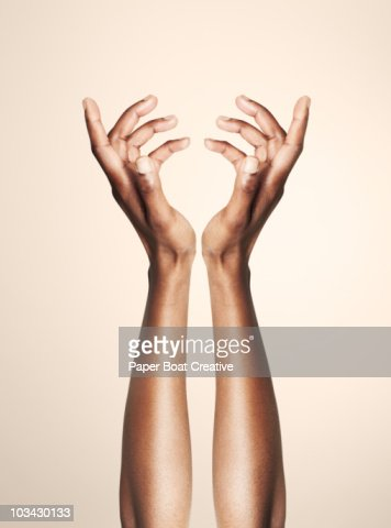 beautiful hands forming an elegant floral shape : Stock Photo