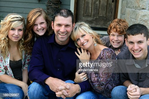 Beautiful happy family of six smiling at the camera
