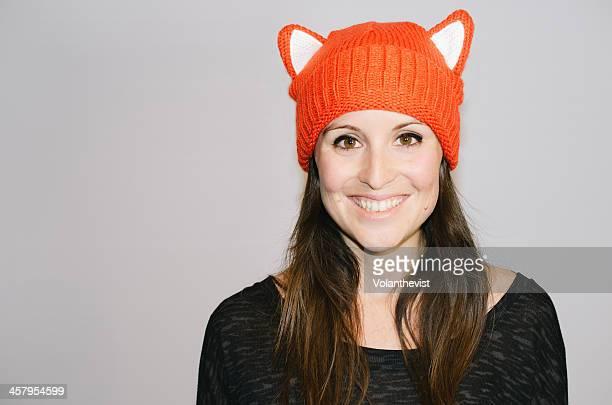 Beautiful happy girl wearing wool hat