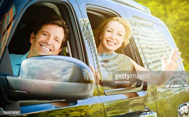 Beautiful Happy Mature Couple in a car