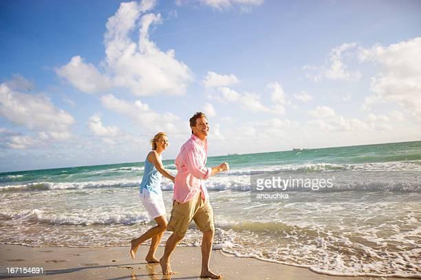 Beautiful Happy Mature Couple Running on the beach