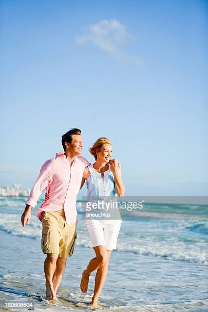 Beautiful Happy Mature Couple Walking on the beach