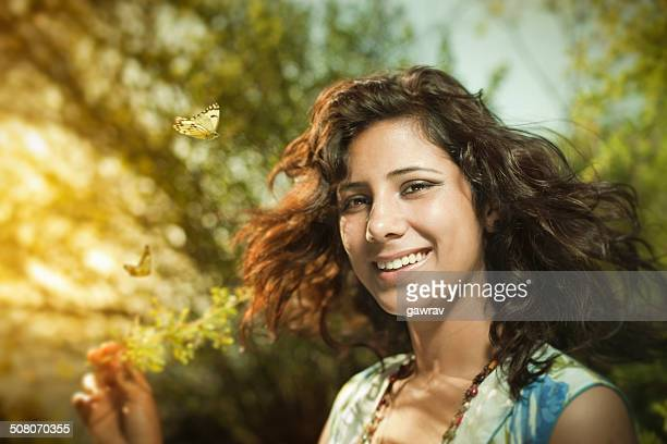 Beautiful, Happy, young woman in sunshine nature with butterflie