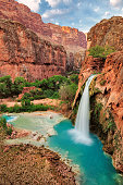 The best waterfalls in the United States in the Grand Canyon and flow with bright turquoise colored water. Havasu Falls, Supai, Arizona