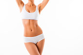 Beautiful healthy fit slim female body on white background