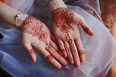 Beautiful henna patterns on hands of bride