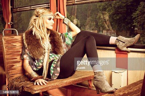 Beautiful hippie in vintage train