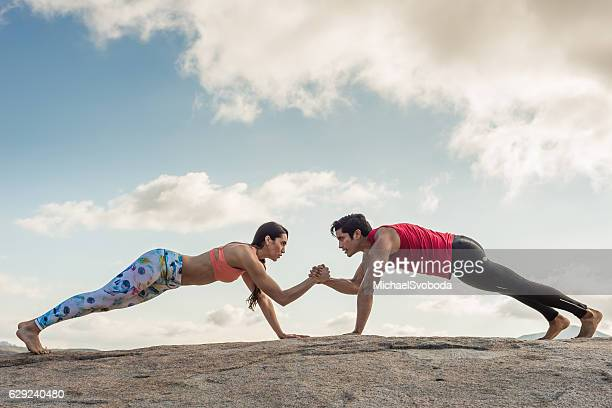 Beautiful Hispanic Couple Exercising Out Outdoors
