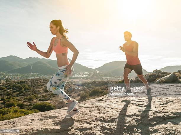Beautiful Hispanic Couple Running Out Outdoors